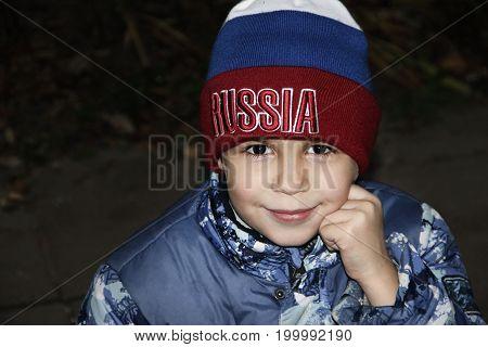 Autumn portrait of a boy with cap Russia
