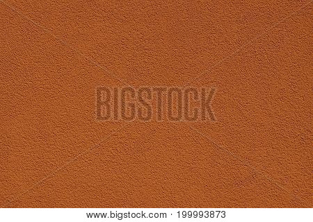 Bright red background of a piece of concrete wall