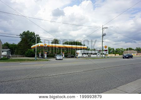 CREST HILL, ILLINOIS / UNITED STATES - JULY 19, 2017: Motorists may purchase gasoline at the Jetsonic Shell gas station on Plainfield Road in Crest Hill.