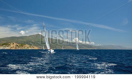 Luxury yachts Regatta at Sea. Sailing through the waves.