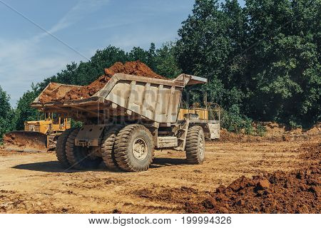Big industrial truck in a quarry at work, industrial transportation concept