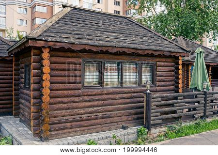 Brown wooden village house of wooden logs
