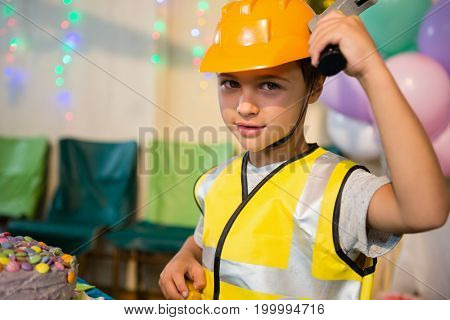 Boy pretending as a worker during birthday party at home