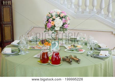 Table set for an event party or wedding reception, green theme