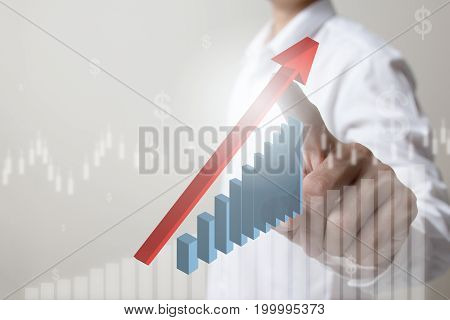 Future of financial business conceptBusinessman touching increasing graph with finance symbols coming.