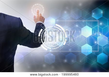 Future of technology network conceptBusinessman holding worldwide network symbols and graphical interface.
