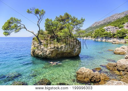 BRELA, CROATIA - 6 JULY, 2017: Paradise Island in the blue Adriatic Sea. Brela, Croatia. Sea coast of Croatia is recognized as one of the cleanest in the world.