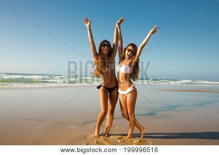 Beautiful girls in a summer day having fun on the beach