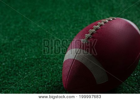 Close-up of American football against black background