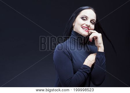 Beauty Ideas. Natural Portrait of Alluring and Sensual Caucasian Brunette Mature Woman in Black Body Suit. Posing Against Black. Horizontal Shot
