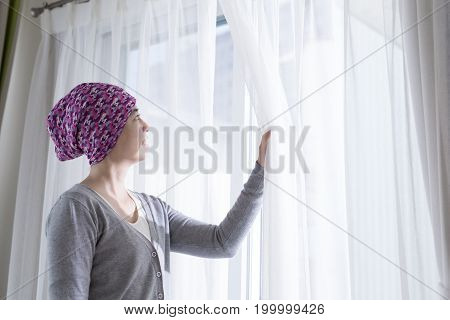 cancer woman feel hope and look somewhere at home