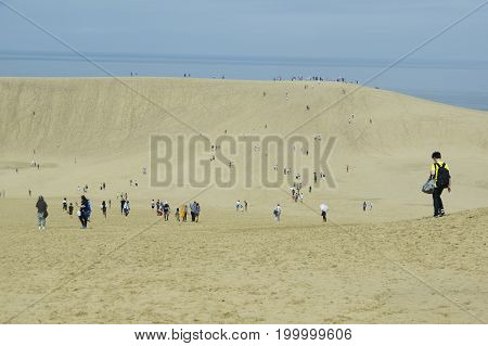 Tottori sand dune in Japan with tourists