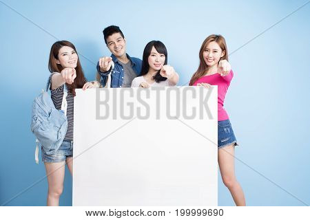 happy group student take billboard on the blue background