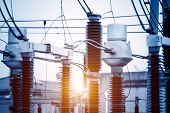 distribution electric substation with power lines and transformers at sunset poster
