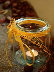 Candle and chestnuts