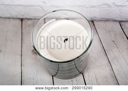 White Wax Candle In Glass