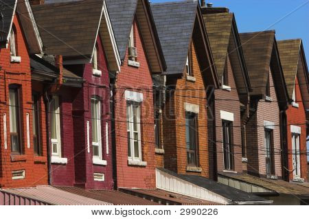 Very colorful row houses that were built in the early 1900's poster