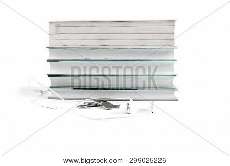 White Headphones And Coins Near The Stack Of Books. Concept Of Cheap Audio Books. White Background W