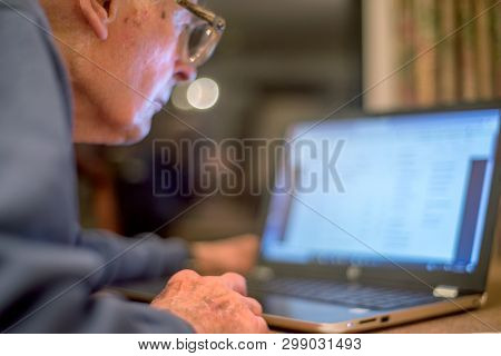 Elderly Man Learning About The Internet,using A Laptop Computer To Check His Share Portfolios ,hamps