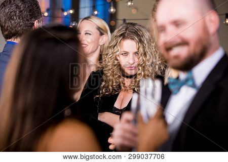 Angry Woman Staring At A Happy Couple At Party