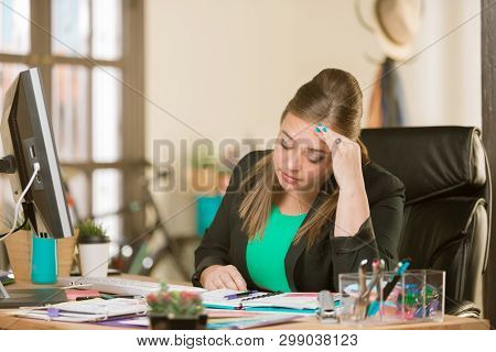 Overworked Creative Professional Woman In Her Office