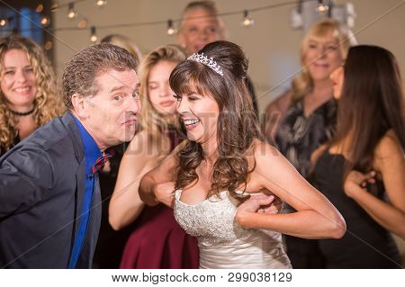 Man And Bride Doing Chicken Dance At A Wedding