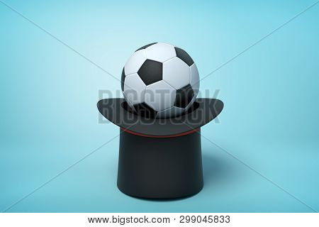 3d Rendering Of Black Tophat Upside Down With Football Inside On Light Blue Background.