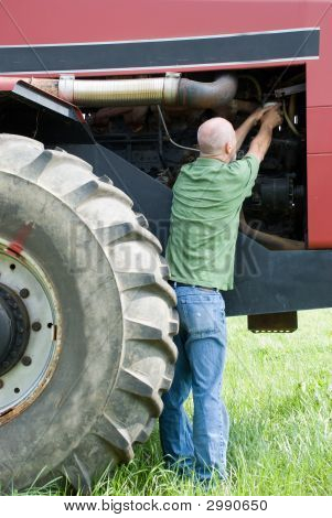 Man Changing Oil Filter On Large Engine