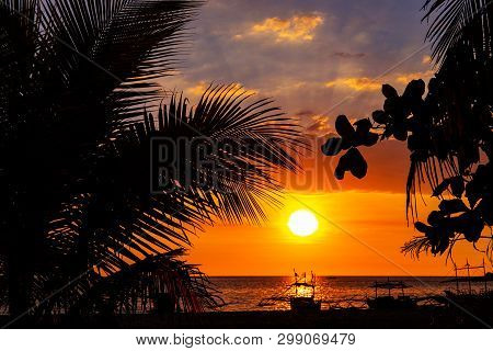 Sunset Sky And Sea Landscape With Wooden Boats. Romantic Seascape On Tropical Island. Orange Sunset