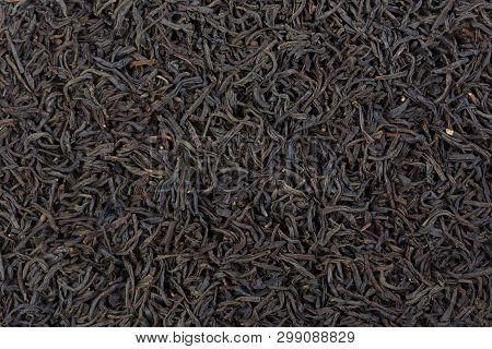 Some Dried And Fermented Earl Grey Tea Leaves Forming A Background Pattern.