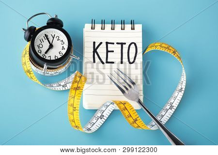 Iintermittent Fasting On Keto Concept On Blue Background