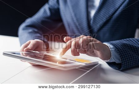 Businessman Hands Using Tablet Computer. Digital Marketing Media Or Financial Diagrams In Virtual Sc