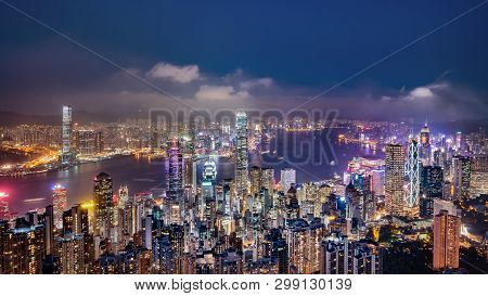 Panorama View Of Hong Kong Skyline On The Evening Seen From Victoria Peak, Hong Kong, China.