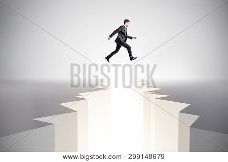Businessman Jumping Over Gap. Difficulty, Challenge And Overcome Concept.