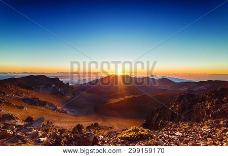 View Of Brown Mountain And Sky During Sunset