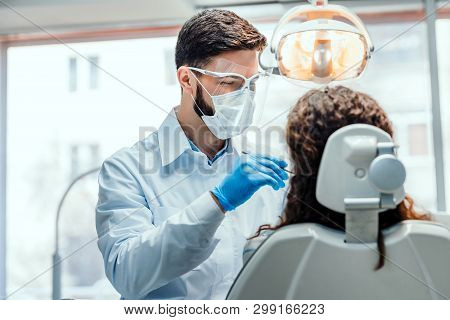 Healthcare And Medicine Concept.young Dentist Working With The Female Patient In A Modern Hospital.