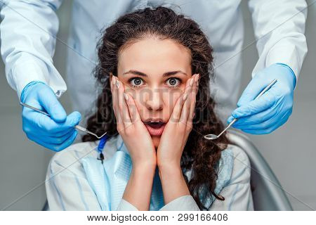 Portrait Of A Scared Woman During Dental Examination.