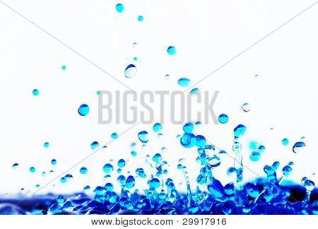 macro of blue water droplets over white, series wa1