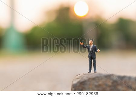 Miniature People : A Politician Speaking On The Rock Cliff And Copy Space For Text