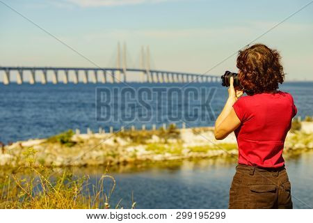 Oresundsbron. Tourist Woman Taking Photo With Camera From The Oresund Bridge Link Between Denmark An