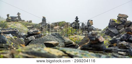 Piled Stones Are Houses For Norwegian Fairytale Trolls. Troll House Made From Stones. Tourists Are B