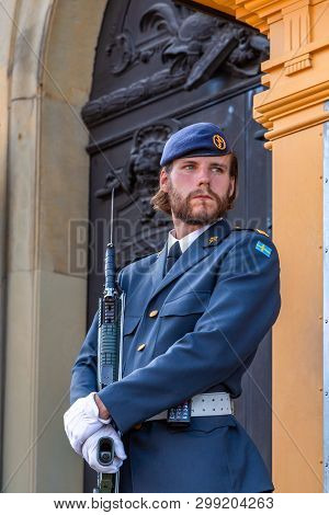 Stockholm, Sweden - June 2016: Royal Swedish Guardsman With Beard In A Modern Uniform With A Gun On