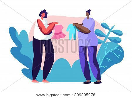 Young Pregnant Women Demonstrate And Brag With Baby Clothing Purchases To Each Other. Happy Female C
