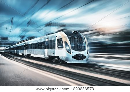 High Speed Train In Motion At The Railway Station At Sunset In Europe. Modern Intercity Train On The