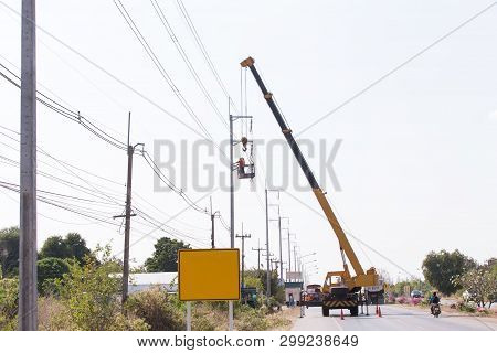 Engineer Electrician Workers On Repairing Electrician Work Installation Of High Voltage In High Volt