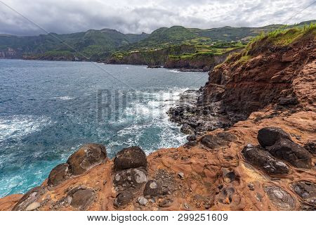 Red Lava Formations Below Ponta Delgada On The Island Of Flores In The Azores.