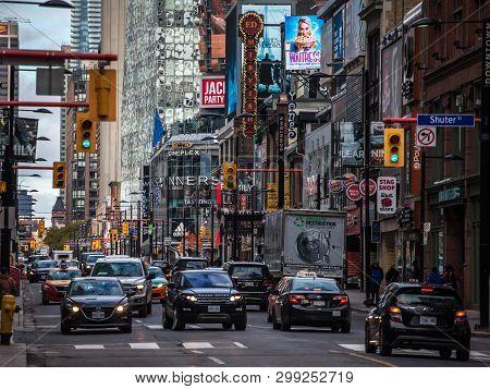 Toronto, Ontario - November 13, 2018: Heavy Traffic On Yonge Street, Downtown Toronto, With Entertai