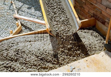 Pouring Cement During Paving Concrete Pavement Near The Driveway