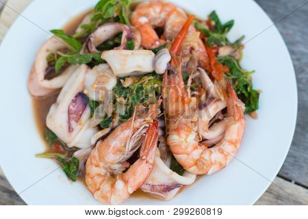 Thai Food; Stir Fired Seafood With Basil. Thai Famaous Traditional And Original Spicy Dish