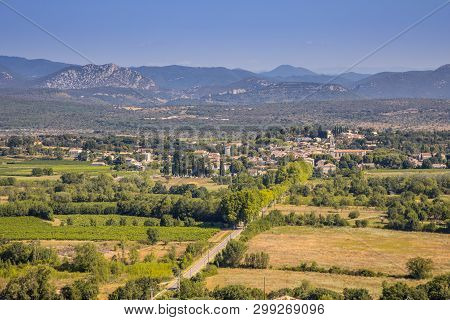 Aerial View Of Saint Hippolyte Du Fort Gateway To Cevennes National Park In Background, Occitania, S